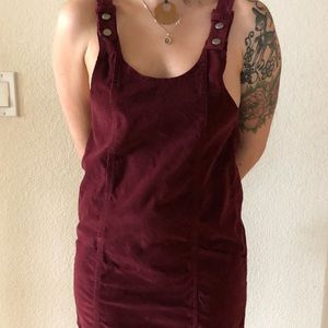 Red corduroy dress with button straps and pockets